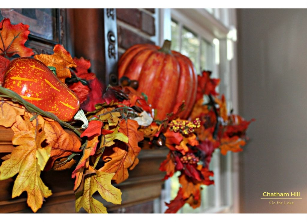Flowing Garland and Tilted Pumpkins on the Fireplace Mantle