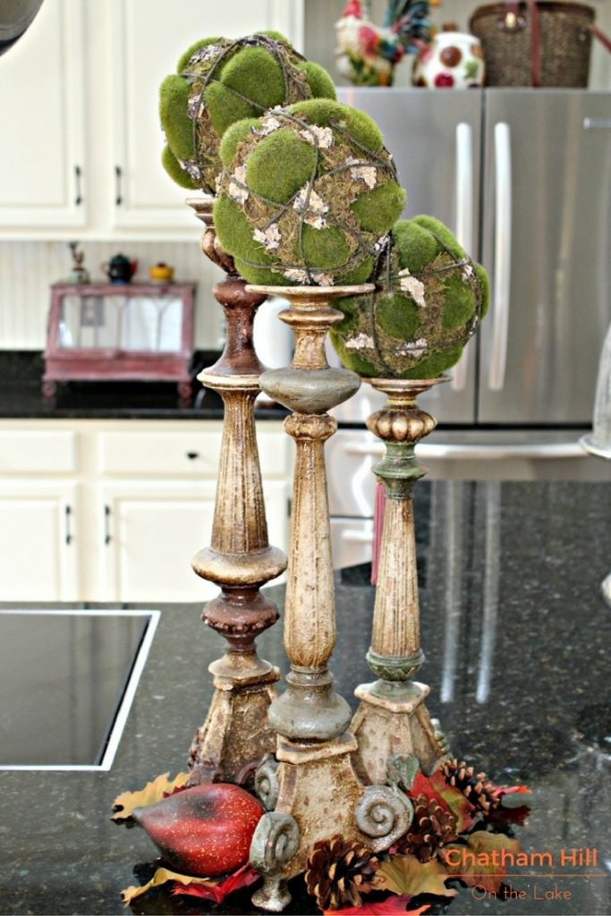 Candle Sticks with Garden Balls www.chathamhillonthelake.com