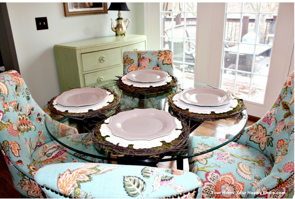 The third layer of this Spring Decor Table are scalloped grey plates www.yourhomeyourhappyplace.com