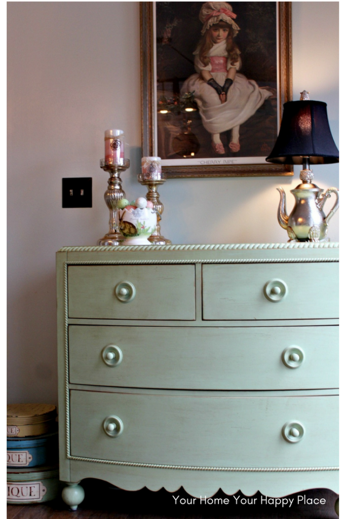 Secrets for success in decorating is tying a picture or mirror on the wall into the table or chest below by having items of height that will reach up into the space of the picture or mirror make the eye see it as one large collage rather than separate things www.yourhomeyourhappyplace.com